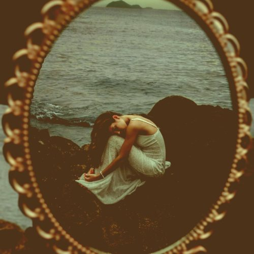 reflection-of-woman-in-white-dress-sitting-on-brown-rock-3819950-antique